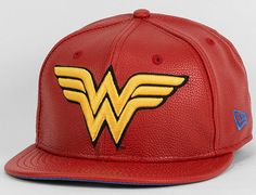 Celebrate DC Comics Amazonian super heroine in the Red Dare Hero Wonder Woman 9Fifty Snapback Cap. This deluxe release is made of a plush red faux leather
