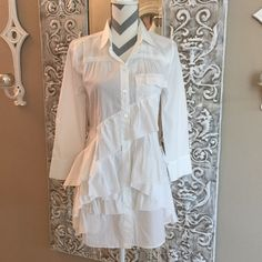 """J Crew ruffled blouse Adorable Ruffles blouse byJ Crew. Sold out. Chest measures 17.5"""" across laying flat, 19"""" 3/4 sleeves & 31"""" long. Pockets on both sides of front & the sleeves are 3/4 length. A really fun top! NWT J. Crew Tops Button Down Shirts"""