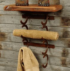 Great recycle of old horse shoes.  Quirky rack for the tack room ?????