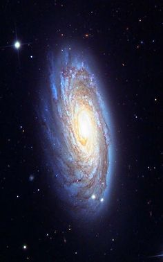 "Messier 74, also called NGC 628, is a stunning example of a ""grand-design"" spiral galaxy that is viewed by Earth observers nearly face-on. Its perfectly symmetrical spiral arms emanate from the central nucleus and are dotted with clusters of young blue stars and glowing pink regions of ionized hydrogen (hydrogen atoms that have lost their electrons)."