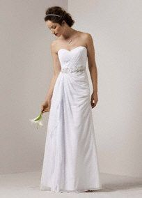Soft chiffon gown features a strapless bodice with a sweetheart neckline. Art deco inspired embroidery at natural waist. Slimming side drape skirt features a split. Floor length. Fully lined. Invisible back zipper. Imported polyester. Dry clean only. Available in white.  To preserve your wedding dreams, try our Wedding Gown Preservation Kit.