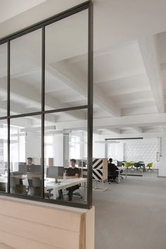 We are now officially suffering from office envy and the object of our feelings is located in Poland, in a former cable factory in Zabłocie, a post-industrial district in Kraków. It was designed for the web technology consulting firm u2i by architect and urban planner Justyna Friedberg of Kraków-based Morpho Studio.