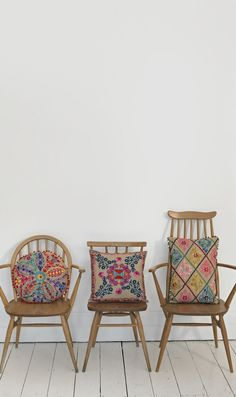 Jute embroidered cushions ~ Plumo. colorful, intricate designs on these old wood chairs..thats my idea of beautiful simplicity in decorating