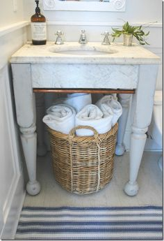 wicker basket Great idea for a small bathroom. Decor, Towel Basket, Remodel, Towel Storage, Eclectic Bathroom, Small Bathroom, Wicker, Bathroom Decor, Beautiful Bathrooms