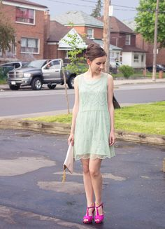 Sparkly, embroidered, sequined green dress.  Faux suede heels, and tassled trim clutch.