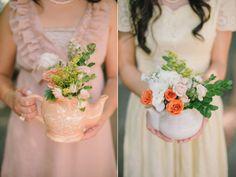 Teapots filled with beautiful florals...so pretty! From http://ruffledblog.com/love-and-hearts-california-wedding/  Photo Credit: http://delbarrmoradi.com/
