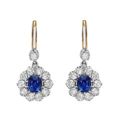 Sapphire & Diamond Cluster Drop Earrings   From a unique collection of vintage drop earrings at http://www.1stdibs.com/jewelry/earrings/drop-earrings/