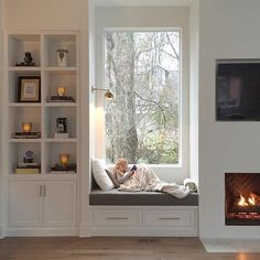 coziest window seat I ever did see - with the perfect built-in and lovely fireplace on either side