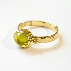 Gold ring with a prehnite. Visit our website and webshop: www.heleenhoogenboom.com