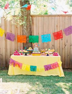 outside dessert table | Outdoor Fiesta Dessert Table with Colorful Flags