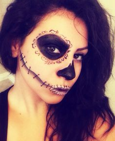 halloween makeup half skeleton.