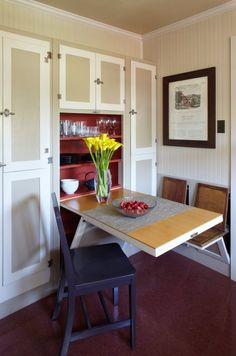 Small Dining Room With Fold Down Dining Table And Chairs Near Cabinet