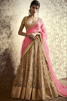 Decent Beige Net Lehenga With Net Choli Beige net semi stitch lehenga with net choli. This lehenga choli is embellished with resham, hand and embroidered .Product are available in 34,36,38,40 sizes. It is perfect for Wedding Wear.  Andaaz Fashion is the most popular designer wear online ethnic shop brands in KIRKLEES, UK.       http://www.andaazfashion.co.uk/womens/lehenga-choli