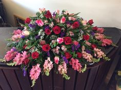 A full Casket spray for a woman in all pink, purple and burgundy coloured flowers. The snap dragons and babies breath add a very interesting texture to this funeral armament. Funeral Bouquet, Funeral Flowers, Funeral Floral Arrangements, Flower Arrangements, Apple Blossom Flower, Casket Flowers, Funeral Caskets, Funeral Sprays, Flower Arrangement Designs