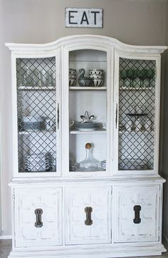 """Sneak Peek: A San Diego Home Full of Handmade Touches. """"This French style buffet cabinet was a lucky Craigslist find.  I bought it from a sweet old man who wouldn't let me give him more than $30 for it! Talk about a steal. I love the open shelving that exposes my favorite dinner and glassware."""" #sneakpeek"""