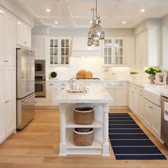 Kitchen Remodel Decor & Design Inspiration for Your Beautiful Home - Narrow Kitchen Island. A pair of polished nickel industrial pendants hang over a narrow kitchen island with white quartzite countertop. Narrow Kitchen Island, White Kitchen Cabinets, Kitchen Redo, Kitchen Layout, Kitchen Countertops, New Kitchen, Kitchen Ideas, Long Island, Kitchen White