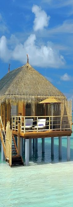 Over the water bungalow at the Moofushi Resort - Maldives.  ASPEN CREEK TRAVEL - karen@aspencreektravel.com