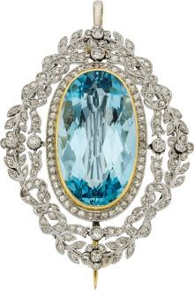 Edwardian Aquamarine, Diamond, Platinum, Gold Pendant-Brooch The brooch features an oval-shaped aquamarine measuring 22.00 x 12.50 x 8.50 mm and weighing approximately 13.00 carats, enhanced by rose-cut diamonds weighing a total of approximately 1.60 carats, accented by European-cut diamonds, set in platinum, completed by a 14k gold pin stem and catch. Gross weight 13.50 grams.