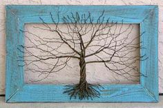 Painted aluminum wire tree that has been constructed to a distressed, salvaged wooden frame made of cedar fence planks. Description from etsy.com. I searched for this on bing.com/images