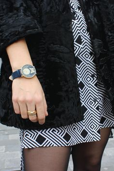 This monochromatic black and white outfit is a chic and sophisticated ensemble. The enchanting Butterfly Watch from Dial gives an additional whimsical and stylish flair!