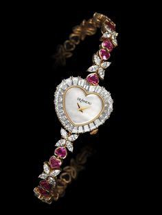 DeLaneau's Delicate Heart jewellery watch is gem-set with baguette-cut diamonds, intense-pink heart-shaped sapphires and 40 navette dia...