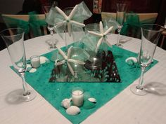 I  purchase all , cut and made centerpieces for tables. Made bow's added starfish to center of them. Will have floating candles. I painted the sea shells, two shades of green turquoise and white...it's the reception colors. Then sea glass will be sprinkled all over.