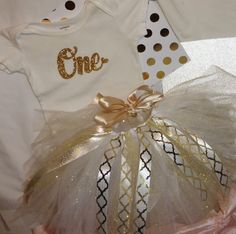 A personal favorite from my Etsy shop https://www.etsy.com/listing/466039907/1st-birthday-girl-outfit-gold-glitter