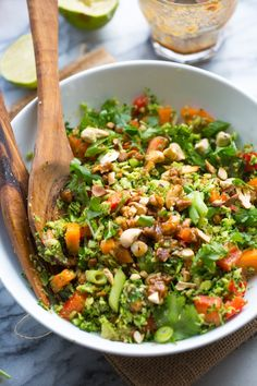 Chopped Thai Broccoli Salad with riced broccoli, carrots, red pepper, spring onion and roasted cashews dressed in a simple almond butter sauce | #Paleo + #Vegan #glutenfree #broccolirice #lowcarb