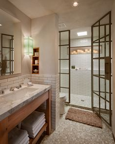 Created by Oz Architects for the Rescue Project at the Phoenix Dream Center. Learn more about this amazing charity  and vote for your favorite room at   www.arizonafoothillsmagazine.com/dreamrooms/  Vanity made in-house from antique reclaimed french oak. Sconces made from reclaimed glass by HighRoad Custom. Floor tile by Stone and Pewter Accents. Fixtures by Waterworks. Candle fixture by Smart Candle. Steel sash window by Janus.