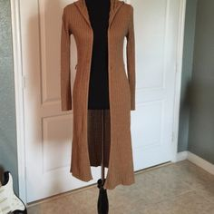 Brown Gold Long Sweater Used Brown Gold Long Sweater with a hoodie, two small holes in the front ... Sweaters Shrugs & Ponchos