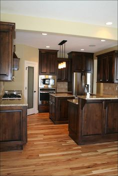 Dark, light, oak, maple, cherry cabinetry and kitchen backsplash ideas with dark wood cabinets. CHECK THE PIC for Lots of Wood Kitchen Cabinets. Dark Wood Kitchen Cabinets, Wood Floor Kitchen, Kitchen Cabinet Colors, Kitchen Flooring, New Kitchen, Kitchen Decor, Wood Flooring, Kitchen Ideas, Kitchen Backsplash