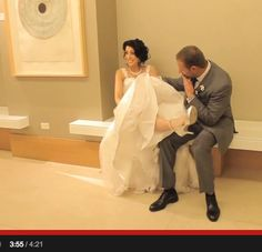 A cute moment of bride Francesca with her Angela Nuran Starletta wedding shoes and her groom
