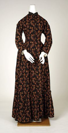 Dressing Gown.  Date: 1880s. Culture: American. Medium: wool, silk, bone. Dimensions: Length: 54 in. (137.2 cm).