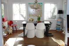the black chair at the head of the table adds a touch of class, who needs the chandelier?