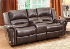 Center Hill Collection Doble Glider Reclining Love Seat with Center Console 9668BRW-2With plush seating that is uncommon in most traditional looks, the design of Center Hill Collection will be a welcome addition to your living room. Offered in bonded leather match, the covering comes in either dark brown or black. With traditional nailhead accent lending an elegant statement to each piece and the easy recline mechanisms adding to the comfort, the lovely Center Hill Collection will provide…