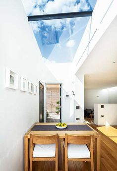 large rooflight over dining table of a small self build