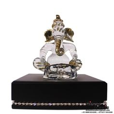 This Ginnie & Ginnie Exclusive Musical Ganesh  is a product from our Statue & Sculptures Collection. It is made of Borosil Glass & wood and it got Fine Gold Plated finish on it. Its approx LxWxH is 5x5x6 inches. It is of approx 730 grams. Unique Code of this product is M400452.06