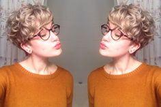 Blonde curly pixie cut.