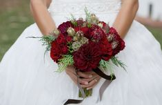red bouquet of dahlias with scabiosa pods Cozy Winter Wedding Inspiration