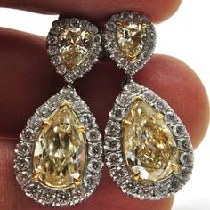 Fancy Yellow Pear shape diamond earrings Right here in Vancouver always beautiful diamonds and rings #wedding #weddingring#diamonds #engagementring#engagement #ring #pretty #diamondring#diamonds #diamondlife #sayyes #ido #love #flawless #bridal#bride #theknot #engaged #vancouverdiamonds #howmuch #fashion #fashionista #highfashion #jewelry#couture #bespoke #boutique #Vancouver