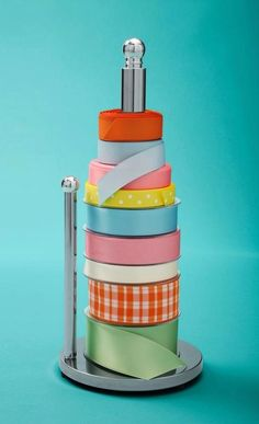 Paper Towel Holder Ribbon Organizer Use a paper towel holder to keep your spools of ribbon organized and easy to get to. I like this idea because you can keep it out on a craft desk or closet shelf where you're more likely to see it and use it.