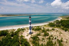 Wild horses, 85 miles of glimmering beaches, the oak-lined streets of historic Beaufort — these are ... - Provided by Redbook