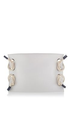 This **Marni** clutch is rendered in leather and features rope detailing and large metal circles lining sides.