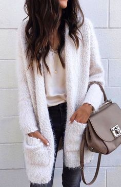 #winter #outfits  white fur topcoat, white scoop-neck shirt, and black denim bottoms