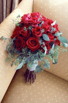 Red roses contrasted by grey eucalyptus leaves. Perfection! Style Me Pretty | Gallery | Picture |