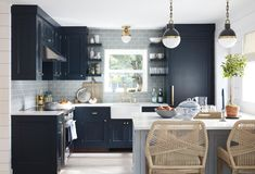 Cool blues and greys ocean-inspired kitchen in The Hamptons. More photos