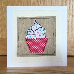 A beautifully crafted, hand stitched Greeting Card. I make each card 100% by hand, cutting the fabric and stitching it together to create the image. A generic card in a unique format, sure to delight the recipient! Each card is presented on a 5 x 5 inch square 300gsm
