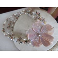 Teresa's special bracelet with a Pink River Shell flower, Sterling... ($140) ❤ liked on Polyvore featuring jewelry, bracelets, sterling silver bangles, pink bangles, pink jewelry, sterling silver jewelry and vintage jewelry