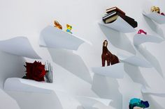 Shelves creating the illusion of floating paper  Designer: YOY