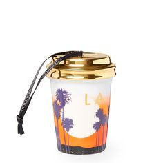 A ceramic cup ornament that depicts the sunset view from Runyon Canyon in Los Angeles, part of the Starbucks Dot Local Collection.